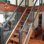 glass and aluminum railing on indoor staircase