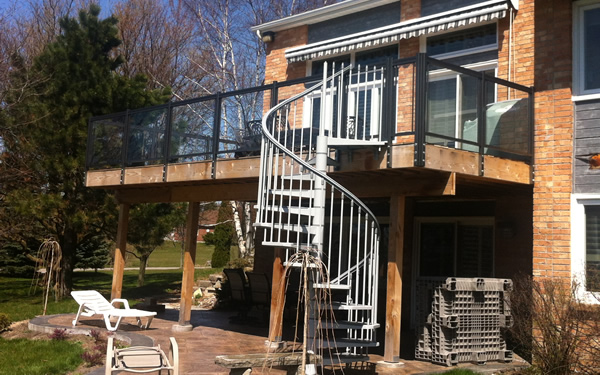 white aluminum railings on spiral staircase