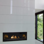 custom glass backsplash on fireplace