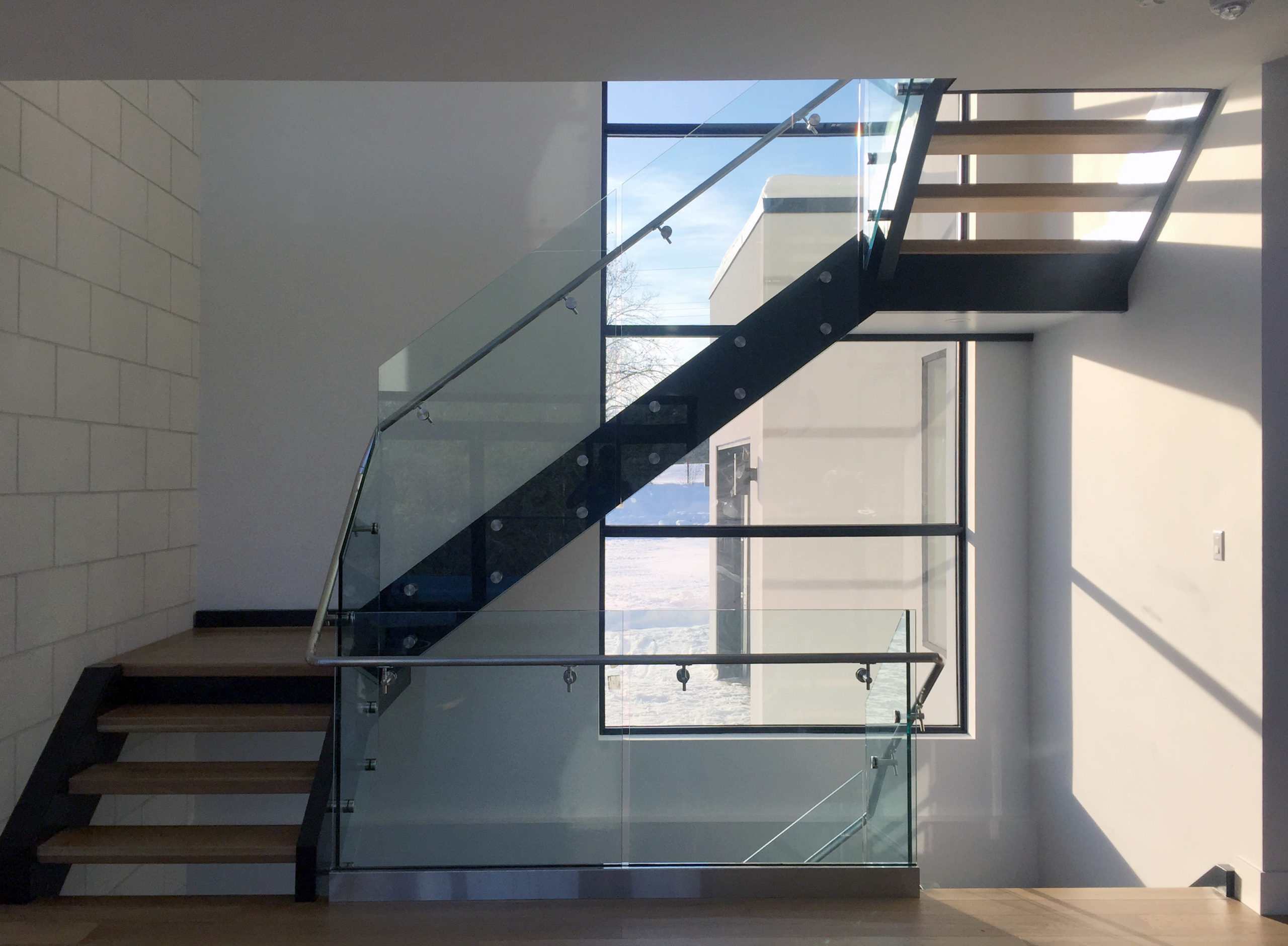 glass railings inside home on staircase